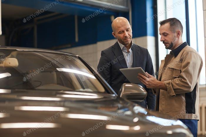 Businessman Checking In Car