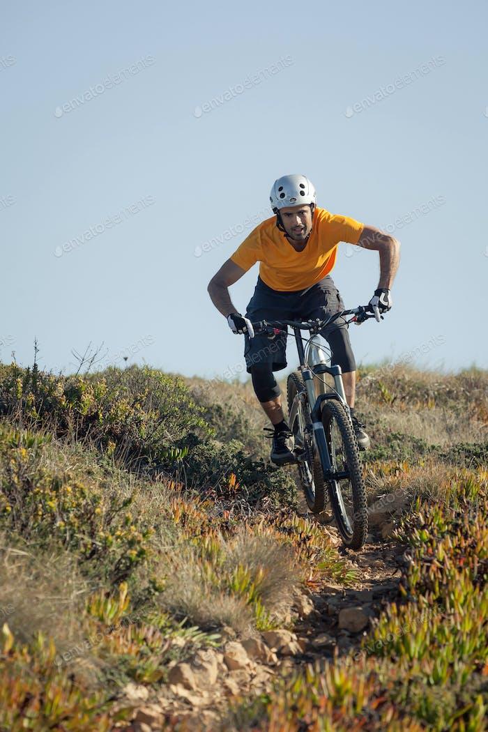 Mountain biker riding dirt trail