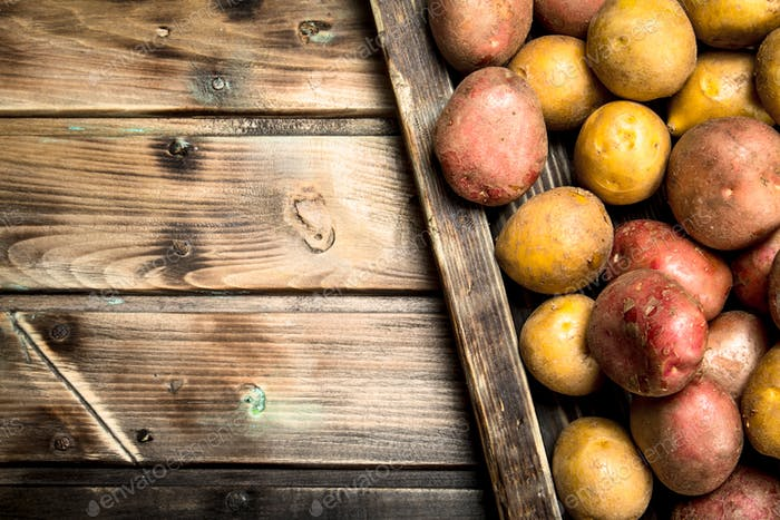 Potatoes on a wooden tray.