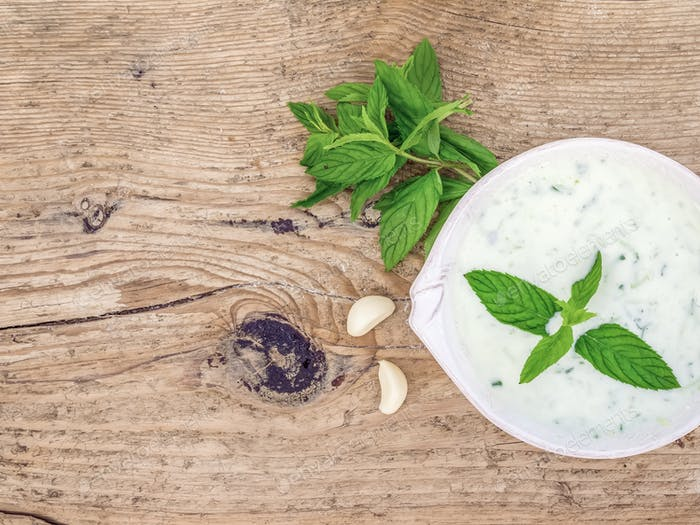 Cold summer yogurt and cucumber soup with fresh herbs