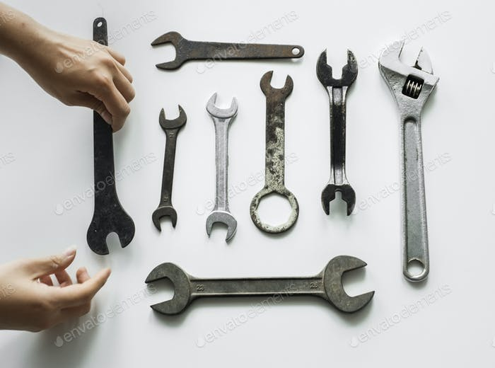 Flat lay of various wrench isolated on white background