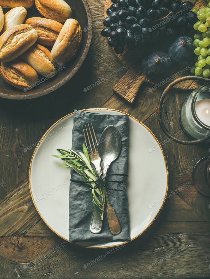 Fall table setting with cutlery and decoration, top view