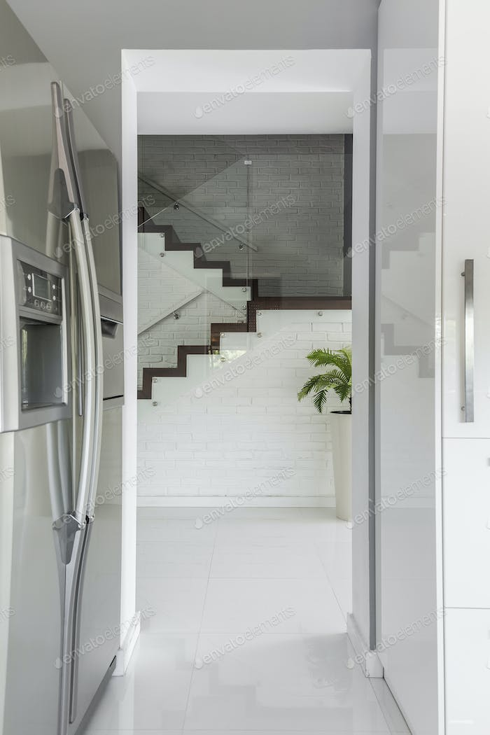 Entrance to kitchen with refrigerator