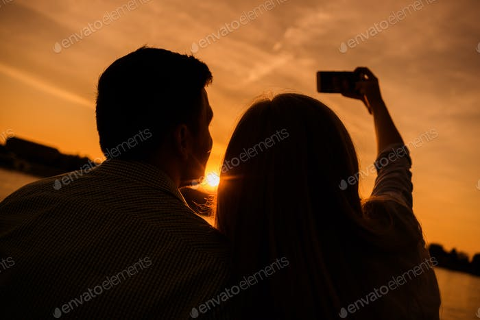 Happy couple in sunset