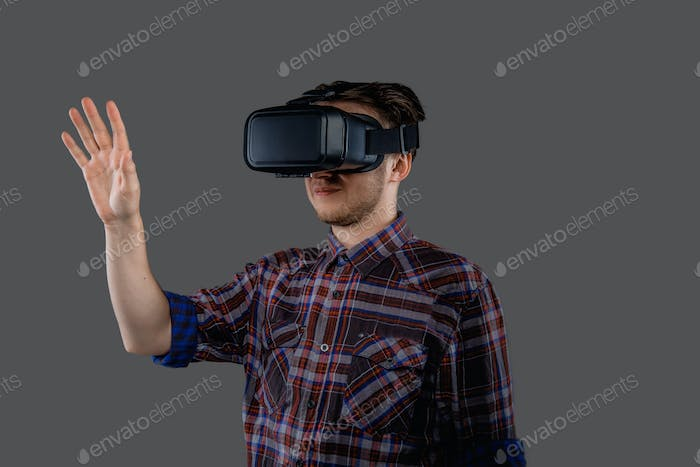 Portrait of male with virtual reality glasses on his head.