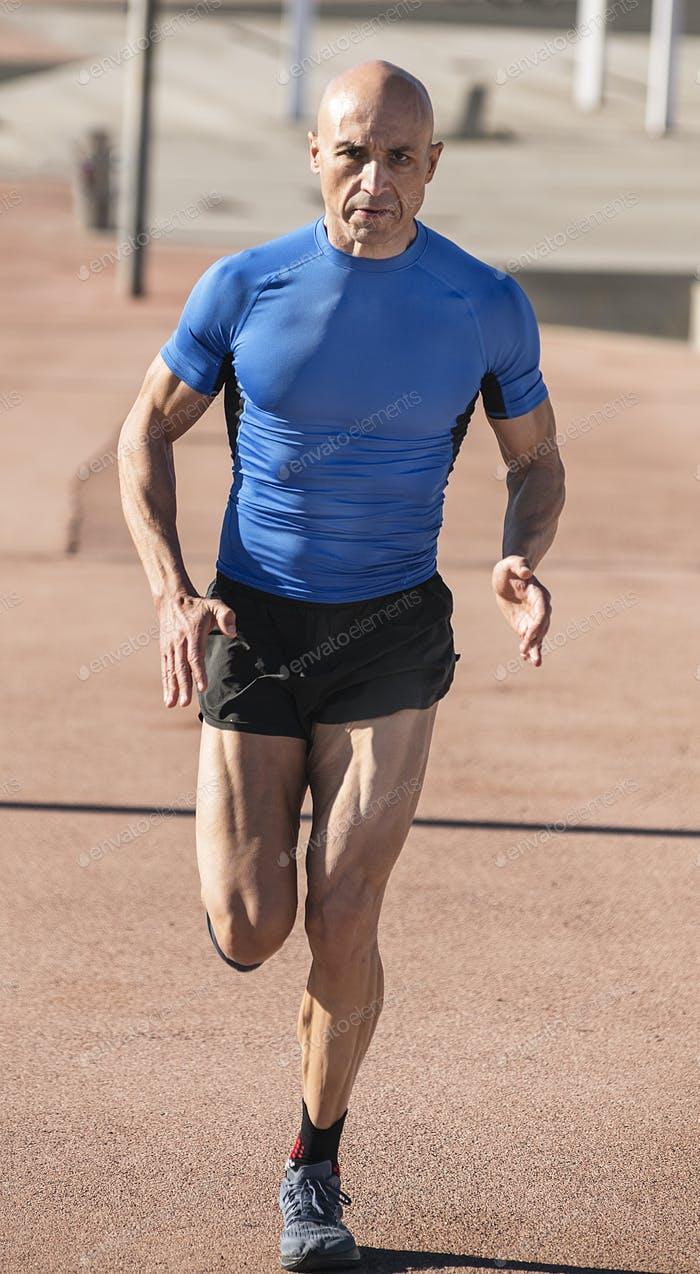 Vertical photo of a sportsman running in a jogging track