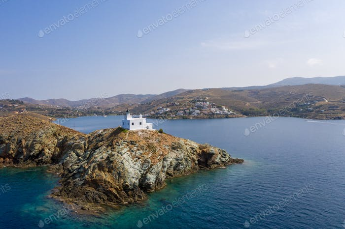 Greece, Kea Tzia island. Lighthouse on rocky cape, sky, sea background.