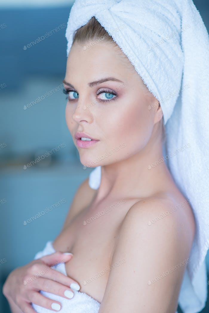 Young Woman Wearing White Bath Towel