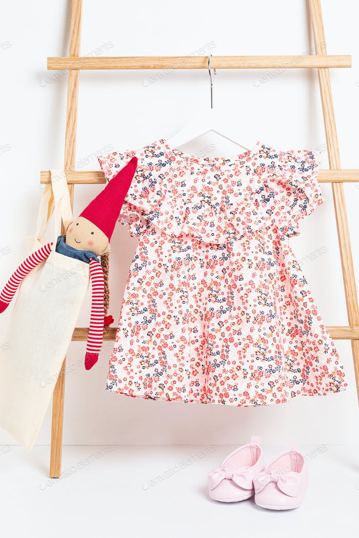 Cute baby clothes hanging on the rack