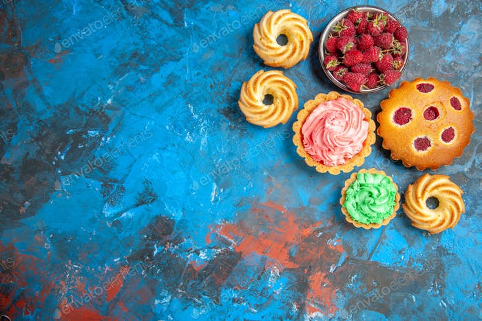 top view raspberry cake small tarts biscuits bowl with raspberries on blue pink background free