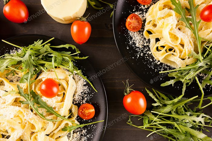 Top view of two plates with pasta