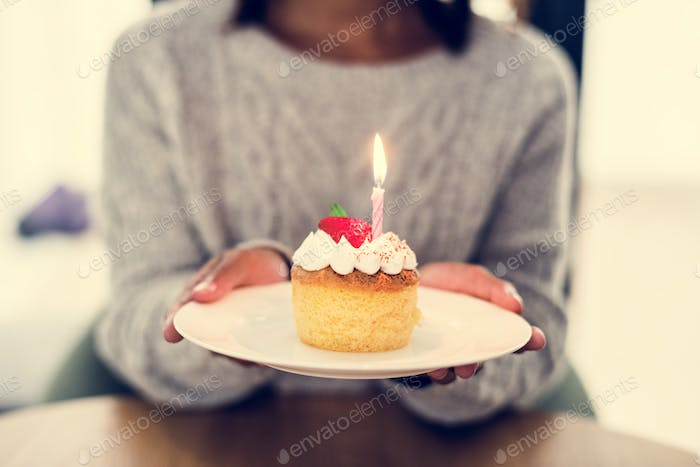 Woman celebrating birthday with a cake