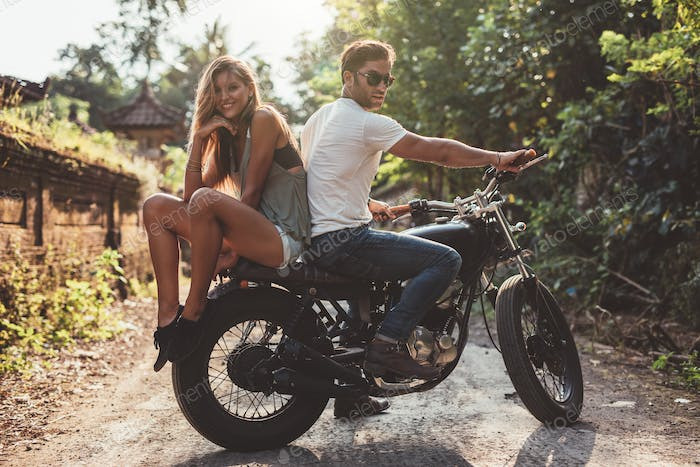 Beautiful young couple on a motorbike