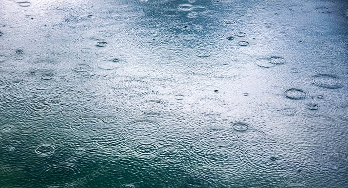 Abstract background, rain drops on the water