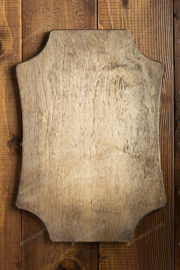 retro sign board at brown wooden background texture