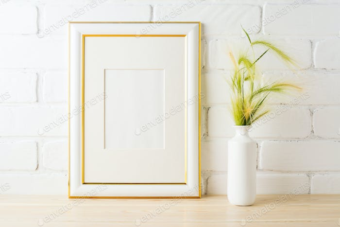 Gold decorated frame mockup with yellow green wild grass ears