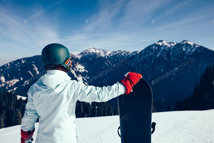 Snowboarder on alpine mountain top