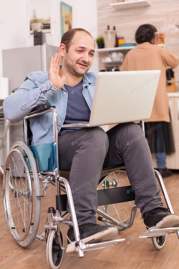 Disabled entrepreneur waving
