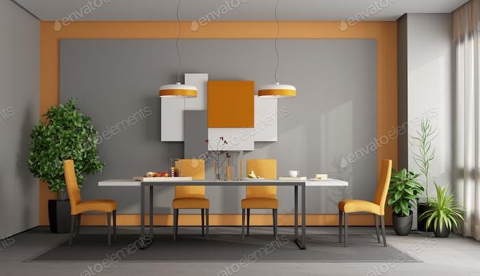 Gray and orange dining room