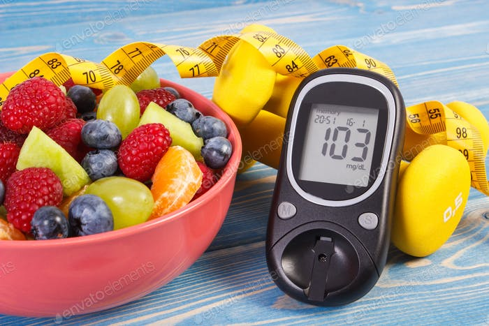 Fruit salad, glucose meter, centimeter and dumbbells
