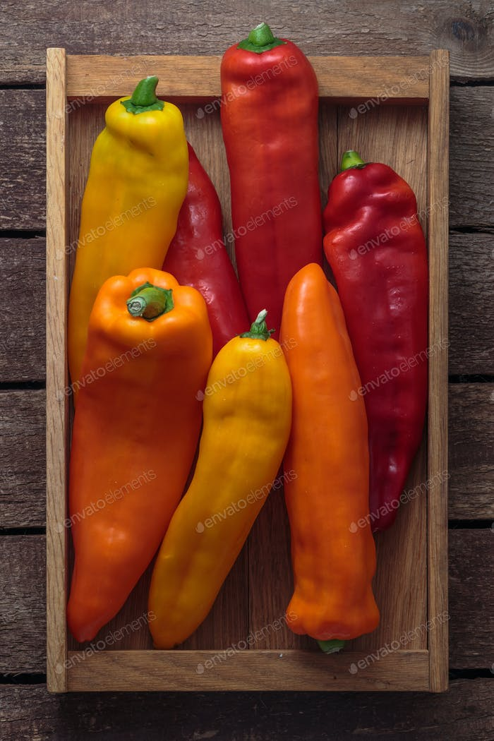 Ripe Colorful Ramiro Peppers on Wooden background