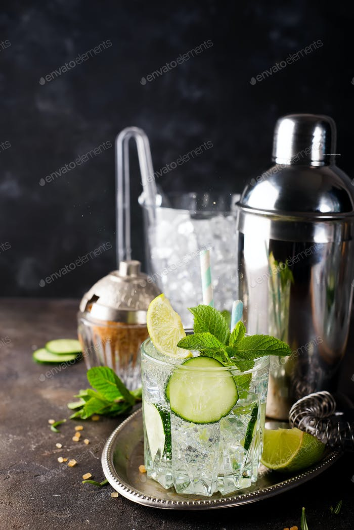 Healthy homemade lemonade with cucumber, basil, lemon, honey and sparkling water,