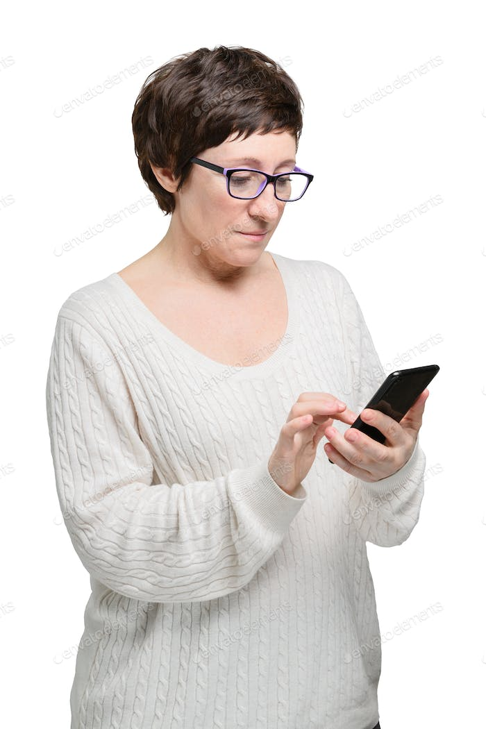 Brunette woman in glasses makes purchases in the online store with phone and credit card