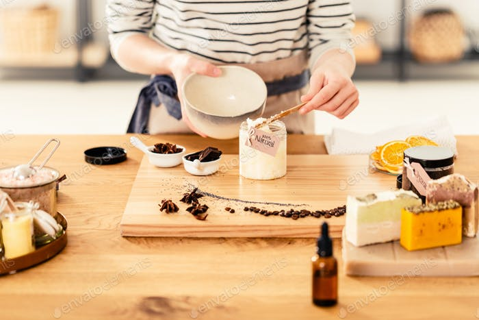 Woman preparing organic face cream