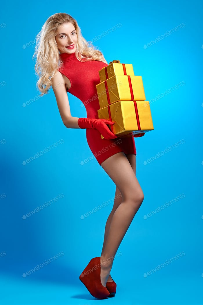 Woman portrait with gifts boxes smiling. Christmas