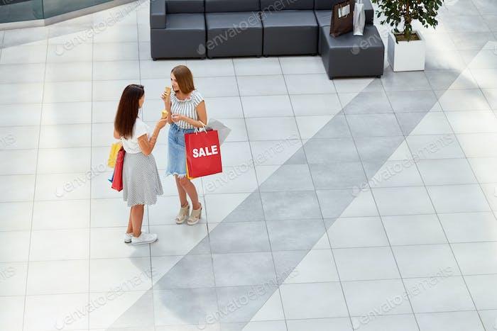 Two Girls in Shopping Center