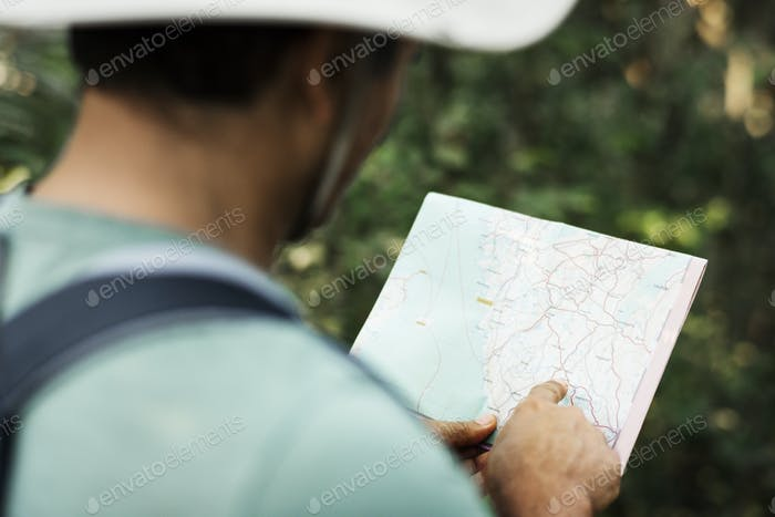 Man finding direction using a map
