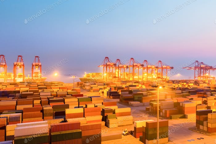 container wharf in nightfall, international import and export trade background