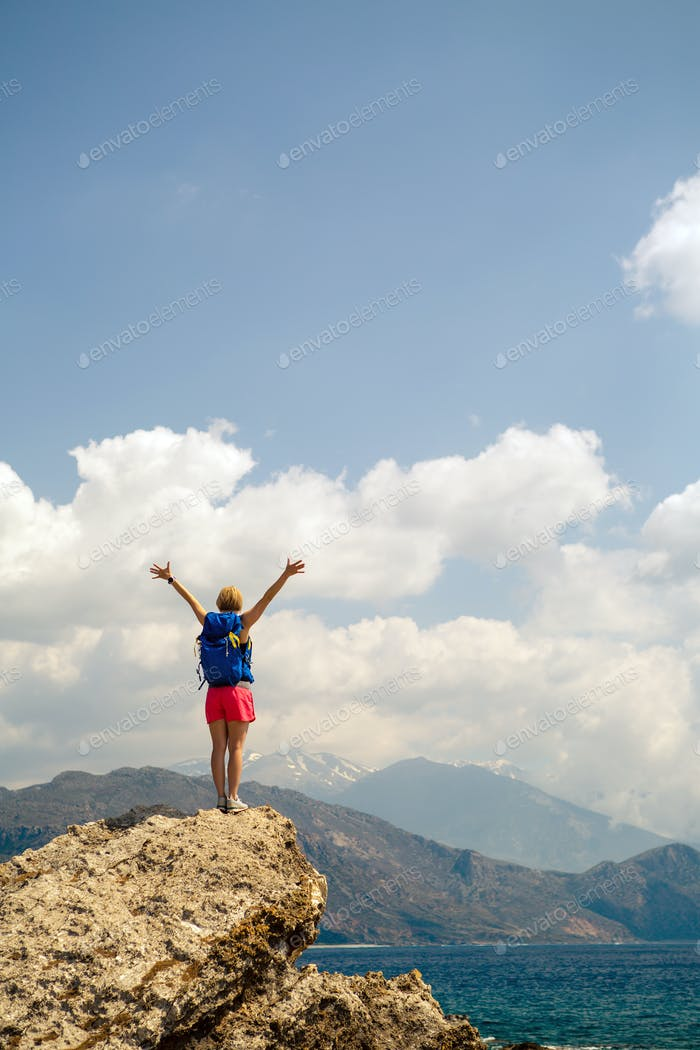 Woman with arms outstretched celebrate mountains sunrise