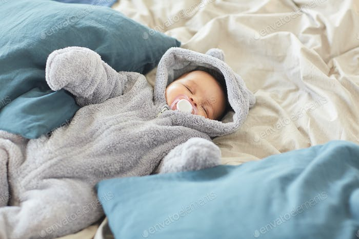 Cute Baby Sleeping on Big Comfortable Bed