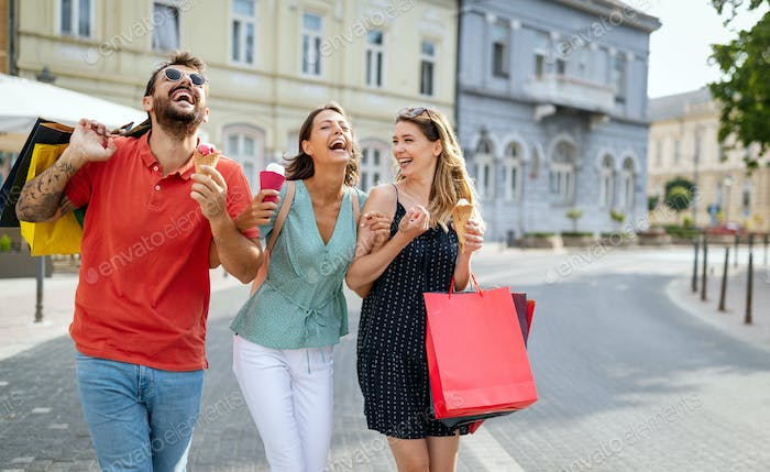 Young friends enjoying shopping and travel in the city. Happy friends shopping