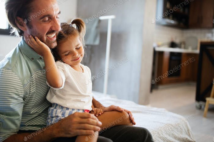 Happy loving family. Father and his daughter child girl playing together