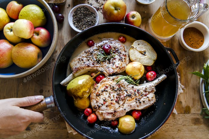 Pork chop cooked with apples food photography recipe idea