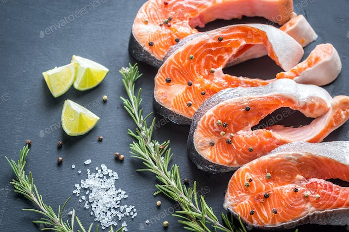 Raw trout steaks on the wooden board