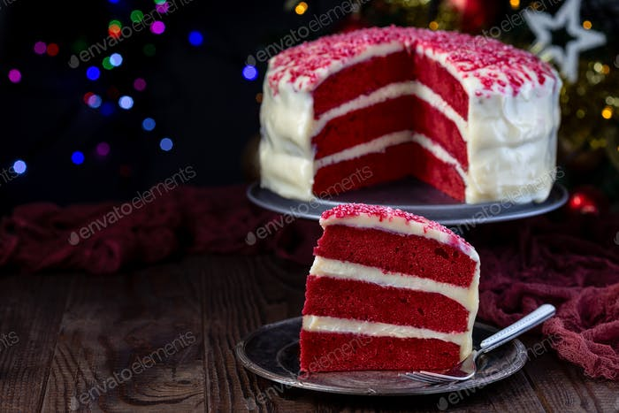 Piece of red velvet cake with cream cheese frosting