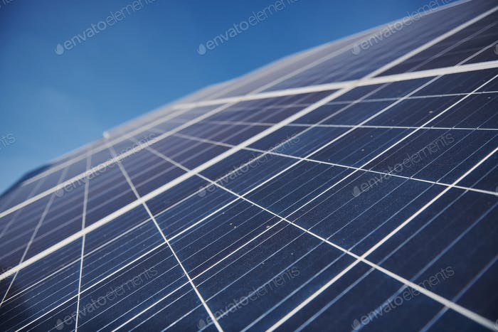 Close up view of polished surface of solar batteries at sunny daytime