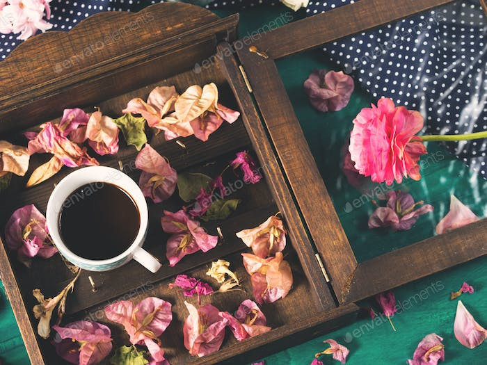 Coffee and flowers on dark background
