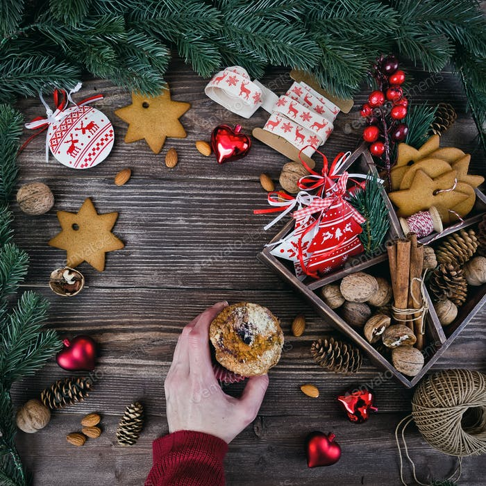 Christmas decoration cookies hanging over the wooden background
