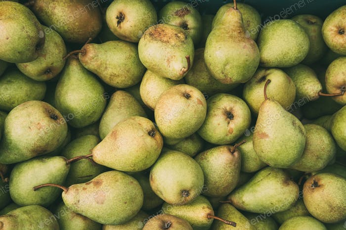 Green Ripe Pears At A Farmers Market. Fruits Background