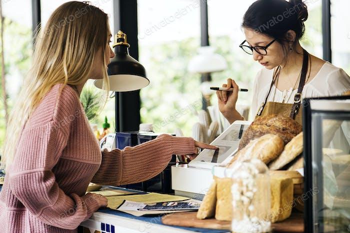 Customer ordering pasrty at counter