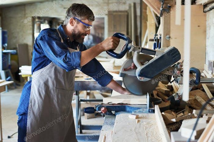 Carpenter Using Electric Cutting Unit