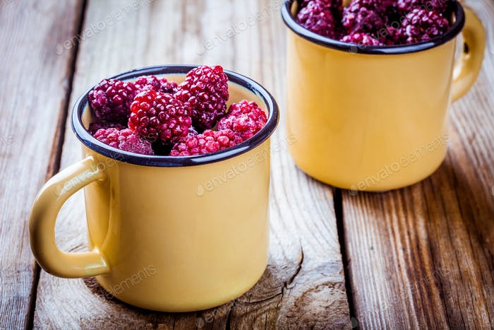 Frozen blackberries in a mugs