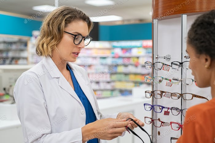 Woman buying spectacles