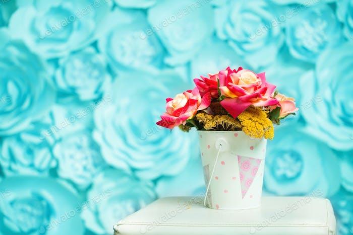 Flowers in a light small bucket