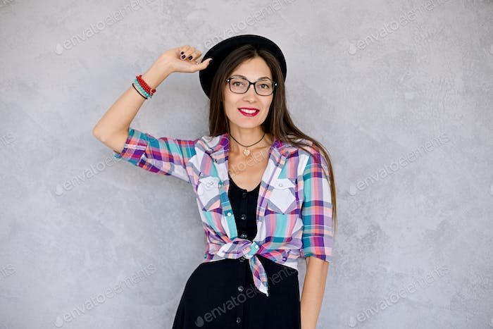 Smiling urban girl with glasses and hat