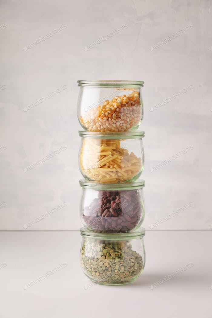 glass jars with pasta, lentils, beans and corn